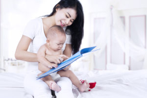 Toys for 6-9 month olds-mom reading to baby-toyfultykes