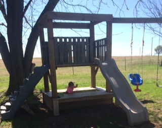 Toddler playing in a play set-toyfultykes