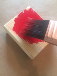 Painting-wooden-block-with-red-paint-theplayfulmoments