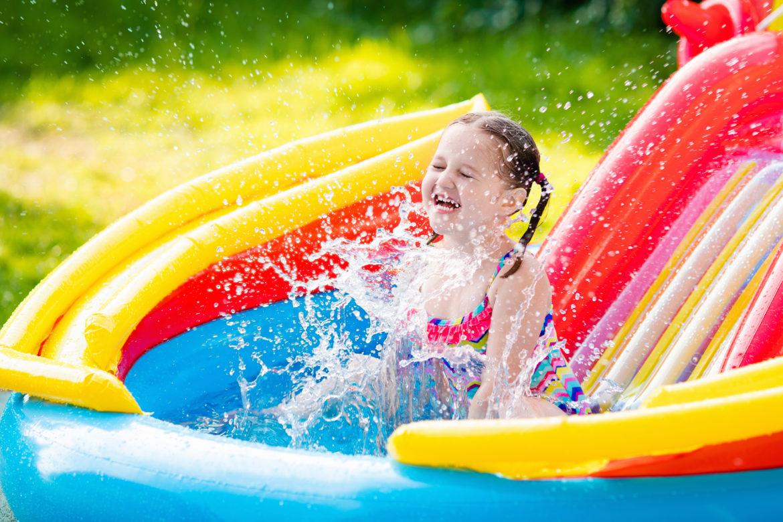 Outdoor Water Fun for Kids-girl in kiddie pool-toyfultykes