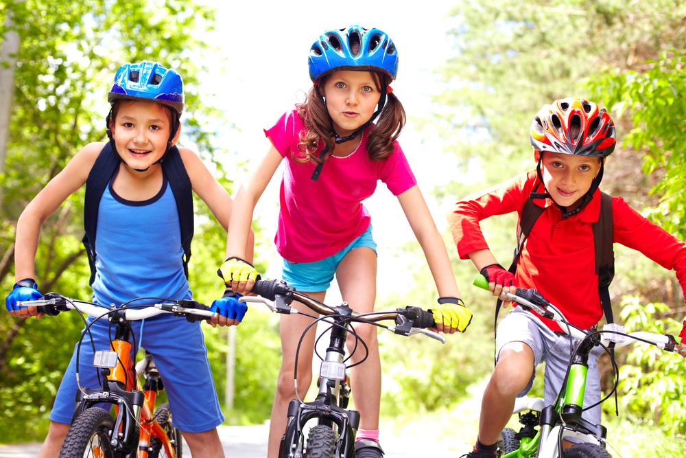 Three children riding bikes