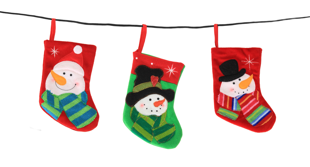Three Christmas stockings with pictures of snowmen on them hanging on a rope