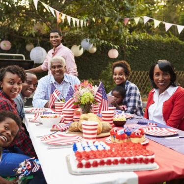 Family eating a fourth of July picnic