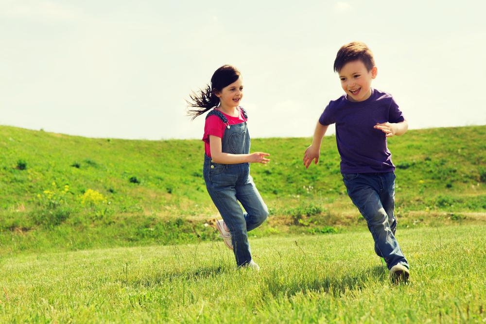 Girl chasing boy outdoors