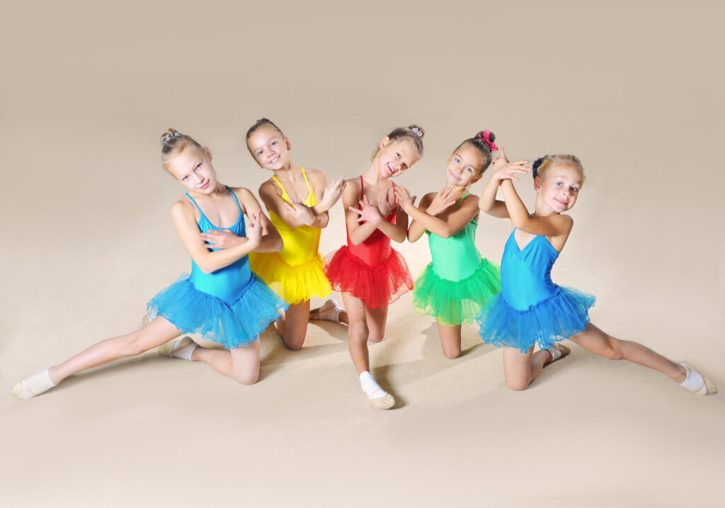 Girl ballet dancers in bright colored outfits