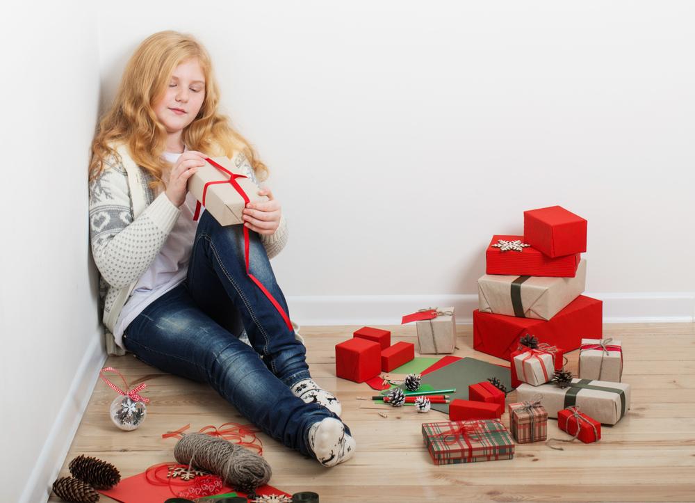 Girl-wrapping-Christmas-presents