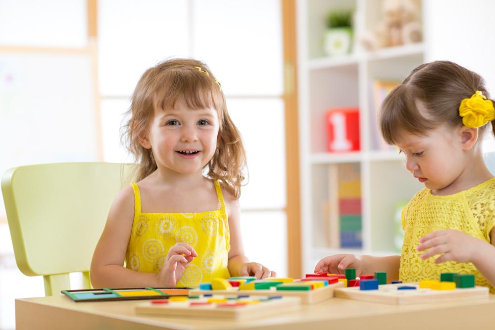 Girls sorting with blocks