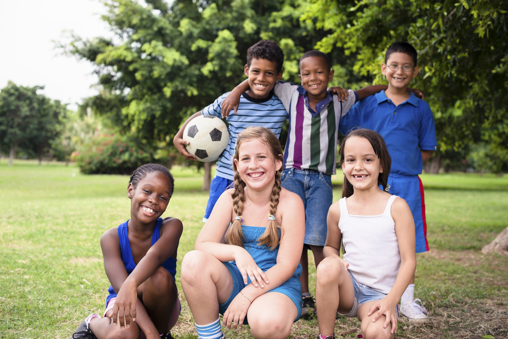 Group of boys and girls with soccer ball