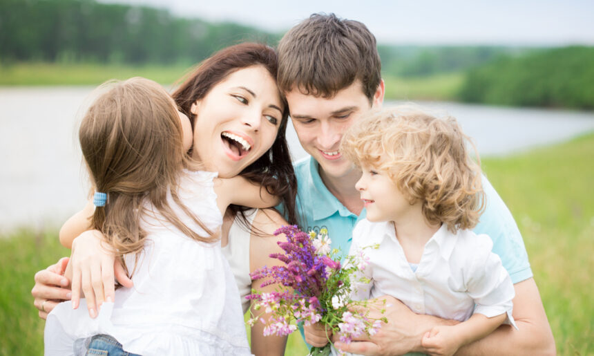 Happy Family in Spring Field