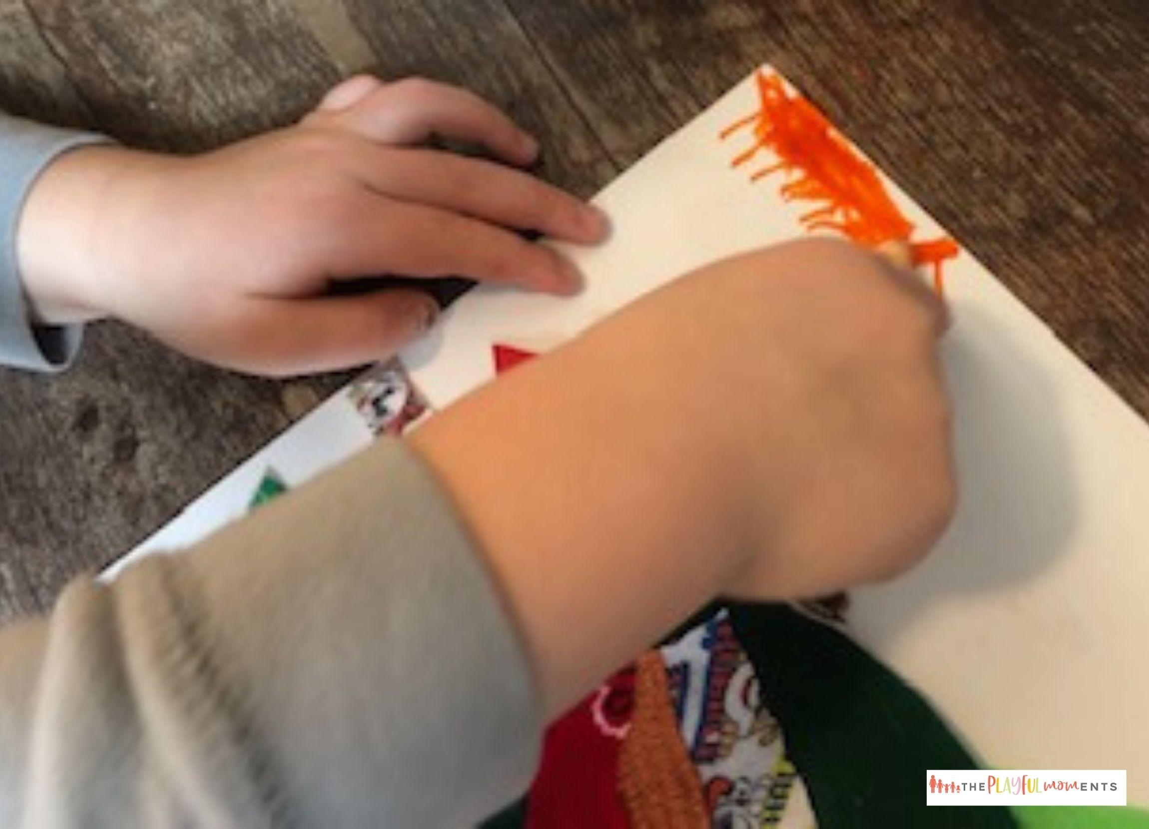 Child coloring sun on fabric turkey craft project