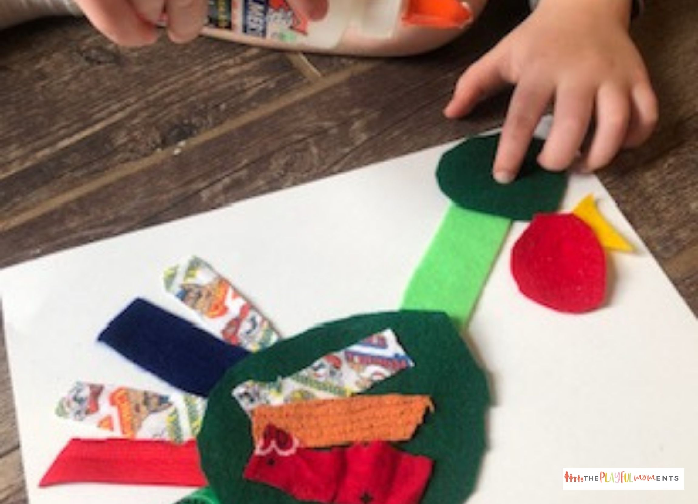 Child gluing turkey made from fabric scraps onto paper