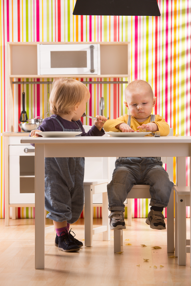 Kids playing in play kitchen