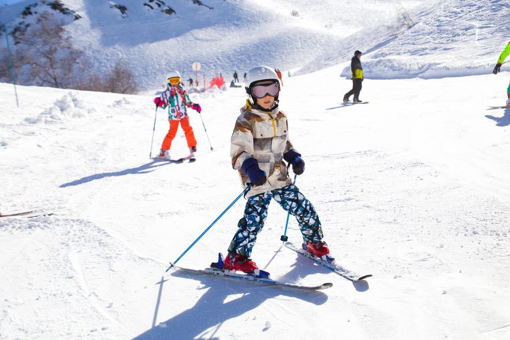 Kids skiing down mountain