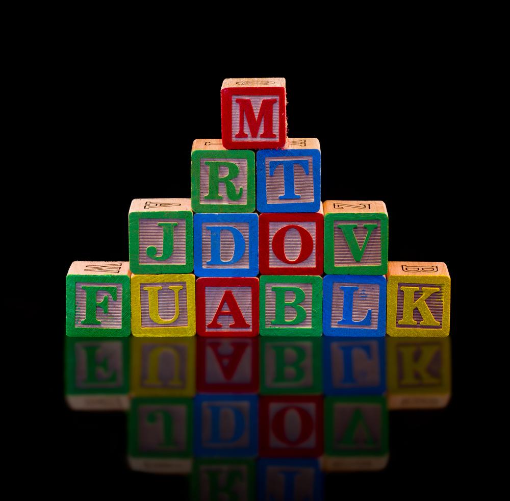 Wooden Alphabet Blocks on Black Background