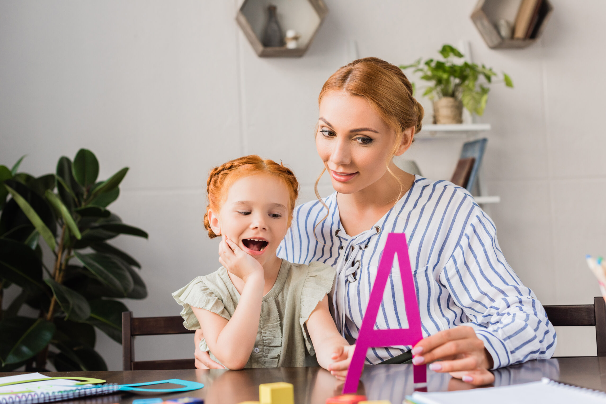 Mother teaching child the alphabet