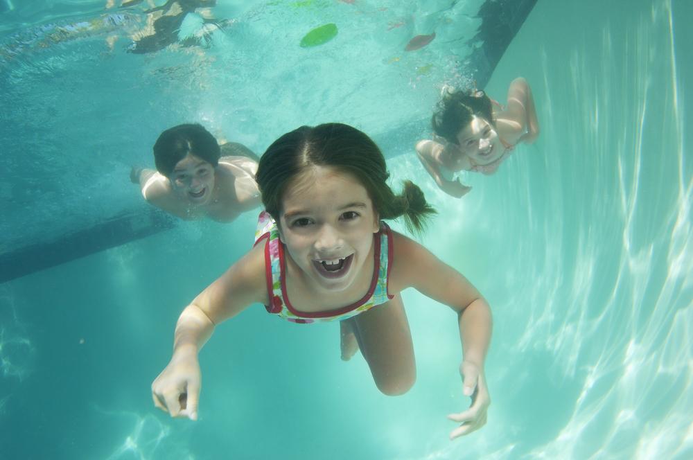 Older kids swimming underwater