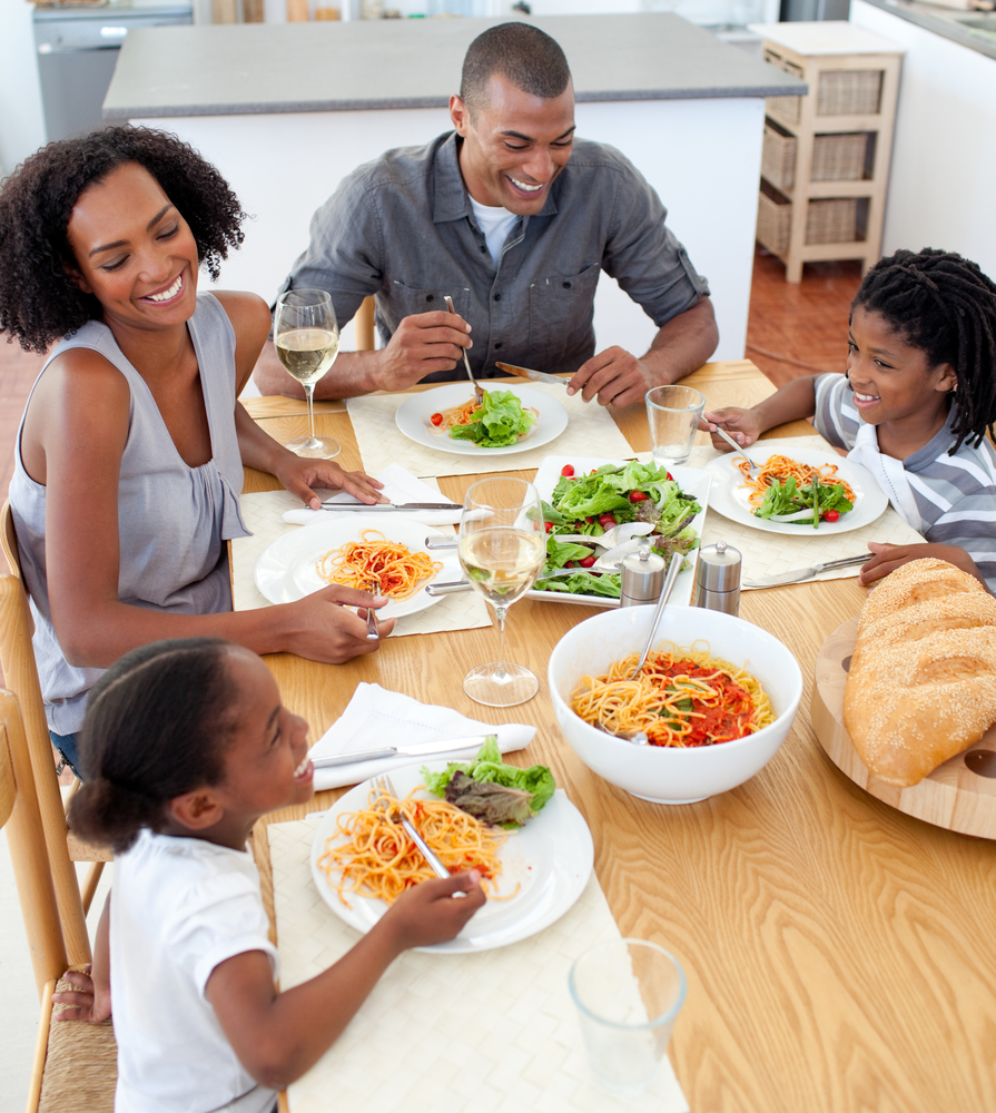 Happy black family dining together at home