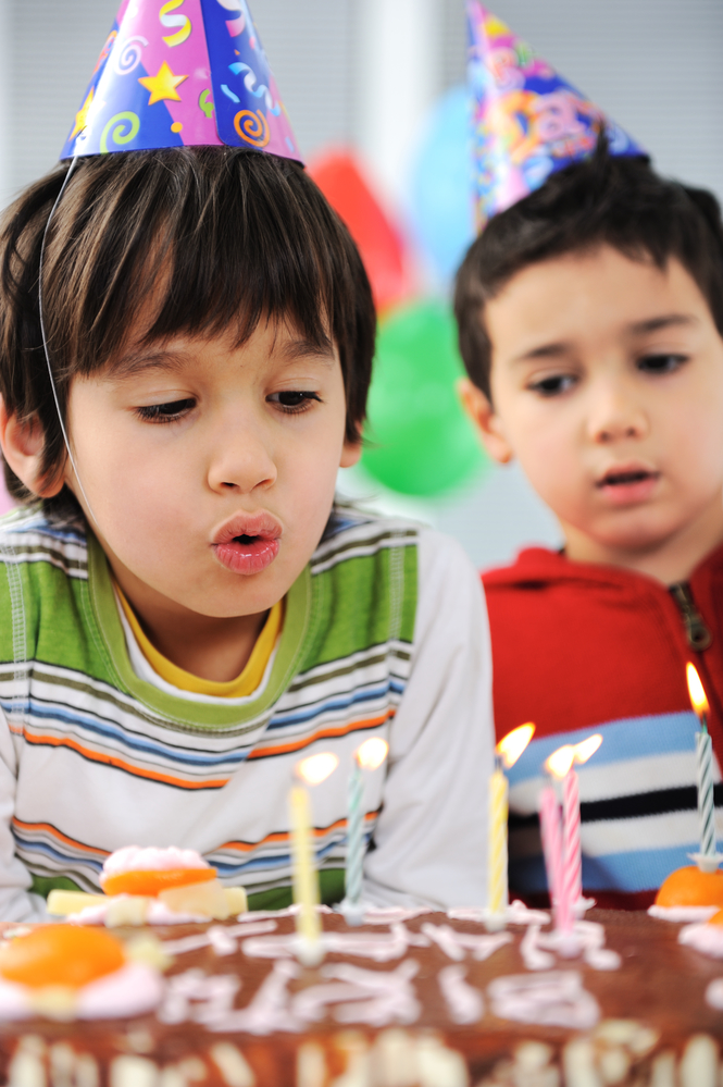 Kids Birthday Party Ideas-Two boys blowing candles on cake-toyfultykes